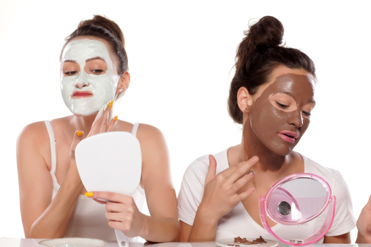 Two young women applied face masks
